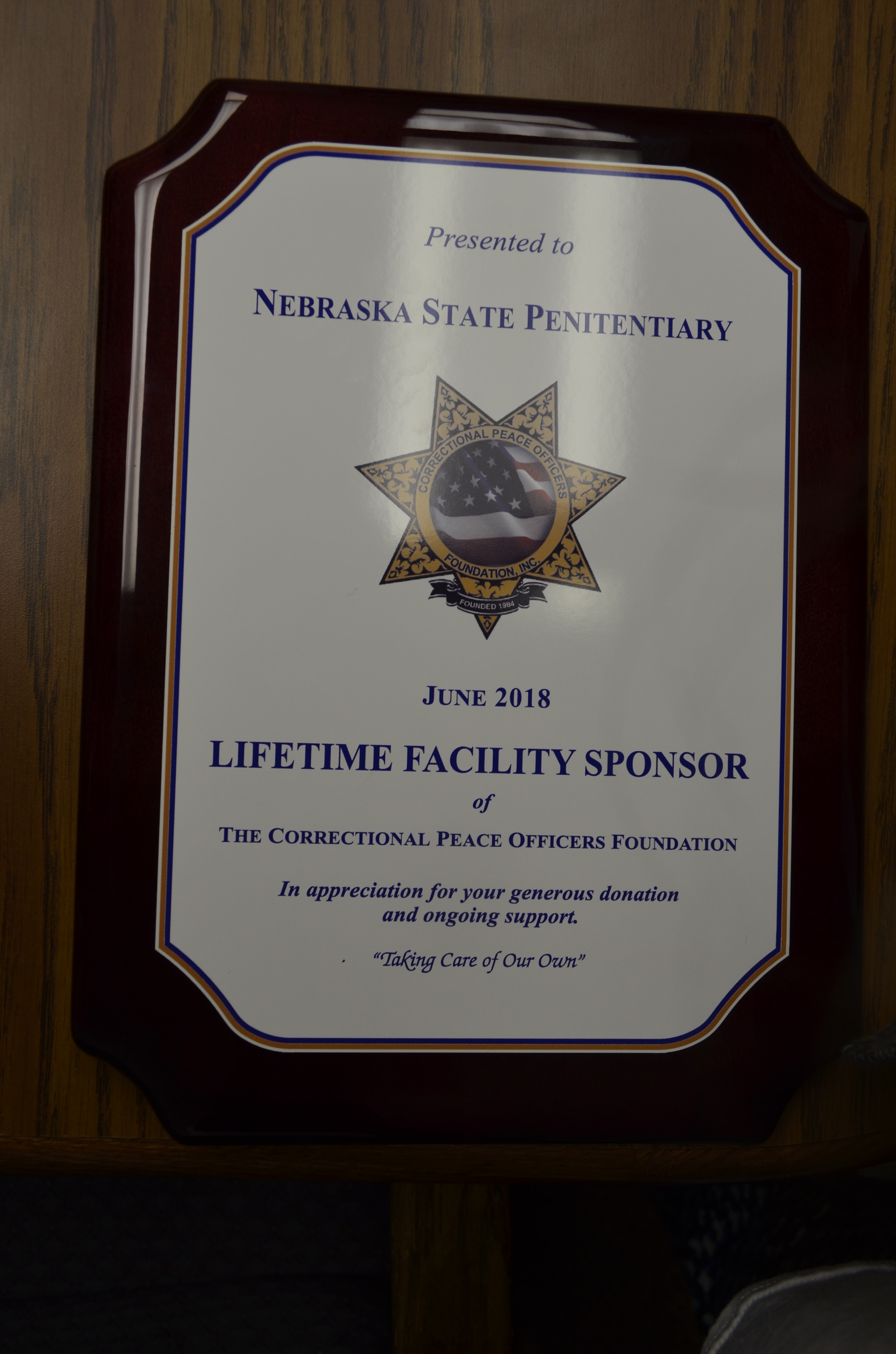 cpof members present nsp with cpof lifetime facility sponsor plaque